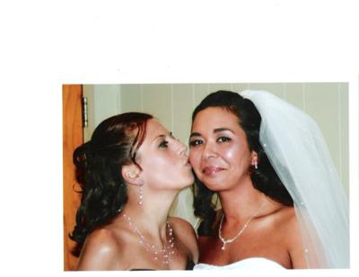 Angel kissing my cheek on my wedding day.